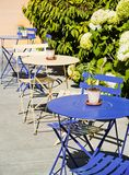 Blue and cream cafe tables outdoors Stock Images