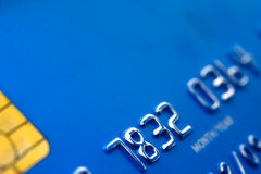 Blue credit card. Close up of blue credit card with partial code and security microchip Stock Photography