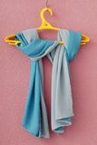 Blue crepe de Chine scarf. Is on lilac background royalty free stock photography