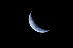 Blue Crescent Moon. A Blue Crescent Moon against a black sky Royalty Free Stock Photo