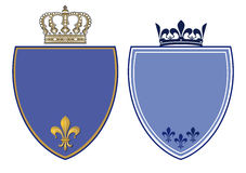 Blue Crests with Royal Crowns. Two blue royal crests or coat of arms with fleur de lis or fleur de lys and crowns on white Royalty Free Stock Images