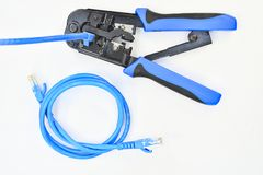 Blue Crimping tool with a computer network cable. Tool Stock Photos