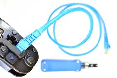 Blue Crimping tool with a computer network cable. Tool Stock Images