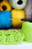 Crochet, yarn and crochet hook Stock Images