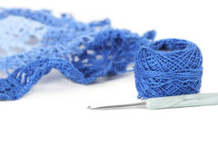 Blue crochet napkin with thread ball isolated Stock Images