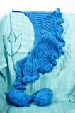 Blue crochet shawl. Blue crocheted shawl, unfinished with yarn balls and hook royalty free stock photos