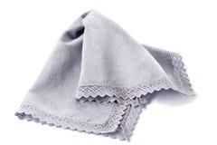 Blue crocheted napkin on white Stock Photography
