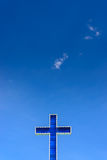 Blue cross on clear blue sky. Stock Photo
