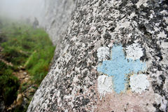 Blue cross hiking and trekking symbol Royalty Free Stock Photo