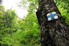 Blue cross hiking and trekking symbol Stock Photos