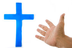 The blue cross on the white wall. The blue cross on the white wall and hand stock photography