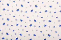 Blue crowns on white fabric. Royalty Free Stock Image