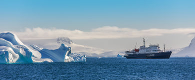 Free Blue Cruise Vessel Among The Icebergs With Glacier In Background Royalty Free Stock Photography - 88037757