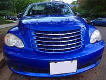 Blue Cruiser. Photo of retro blue chrysler pt cruiser. This car was built around the concept of a car for surfers or young people who live the carefree stock images