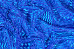 Blue crumpled nonwoven fabric background Stock Photos