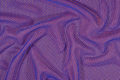 Blue crumpled nonwoven fabric on a orange Royalty Free Stock Images