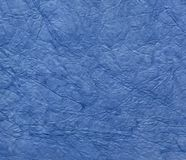 Blue crumpled paper texture background. Stock Image