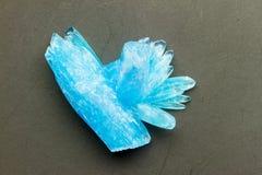 Blue crystal on black Stock Photos