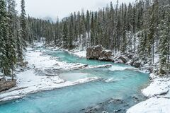 Blue crystal clear river at winter