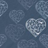 Blue crystal diamond hearts on dark blue Royalty Free Stock Photography