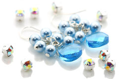 Blue Crystal Earrings And Beads Royalty Free Stock Photos