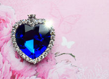 Blue crystal heart on pink background Stock Image