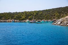 Bay with crystal blue water of Mideterranean sea Aegean Turkey, Bodrum. Blue crystal water of Mediterranean sea Aegean in bay near the Turkey, Bodrum. Tourists royalty free stock image