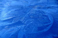 Blue Crystals. Close up of Ice crystals which had formed on a metallic blue metal Royalty Free Stock Images