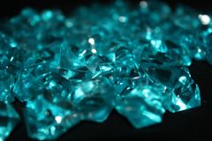 Blue crystals on a black background stock photo