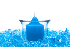 Blue crystals and candle Stock Photos