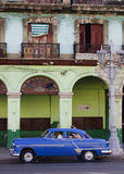 Blue Cuban Car in front of building. Havana, Cuba- January 2, 2011- Blue cuban car in front of old bulding Stock Photography