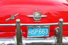 Blue Cuban license plate on red car Stock Photography