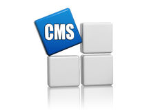 Blue cube with letters CMS on boxes Stock Photos