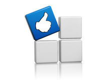 Blue cube with like sign on boxes. 3d blue cube with like sign on grey boxes Stock Photos