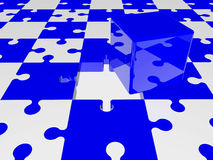 Blue cube on puzzle pieces in blue and white colors Stock Image