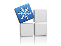 Blue cube with snowflake symbol on boxes. Snowflake sign - 3d blue cube with white symbol on grey boxes, winter seasonal concept Stock Images