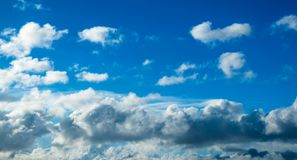 Blue cumulus clouds. In the clear summer sky stock photos