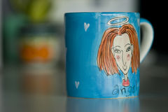 Blue Cup. With angel image Royalty Free Stock Photography
