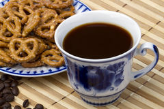 Blue cup and baking. Blue cup with coffee, black coffee beans and baking Stock Photos