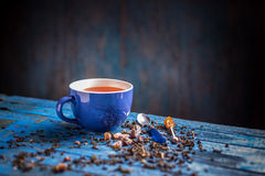 Blue cup with black tea Stock Photography