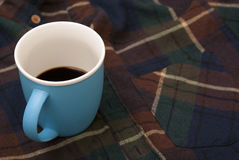 Blue cup with the blue handle Royalty Free Stock Images