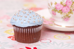 Blue cup cake with tea cup Stock Image