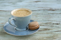 Blue cup of cappuccino Royalty Free Stock Photo