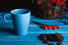 Blue cup for tea with chocolate biscuits and herings on the tabl Stock Image