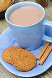 Blue cup of cocoa with cinnamon and oatmeal cookies close-up Stock Photography