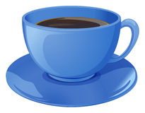 A blue cup with coffee Stock Image