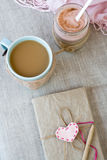 Blue cup of coffee in Knitted sweater, homemade berry yogurt Stock Photo