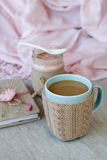 Blue cup of coffee in Knitted sweater, homemade berry yogurt. Vintage notebook for records Royalty Free Stock Photo