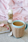 Blue cup of coffee in Knitted sweater, vintage notebook Stock Images