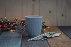 A blue cup of coffee on the tablen Stock Photography